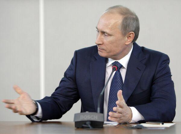 Премьер-министр РФ Владимир Путин на пресс-конференции по итогам Международного форума по проблемам, связанным с сохранением тигра на Земле