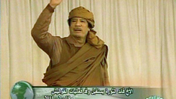 Ливийский лидер Муамар Каддафи во время выступления