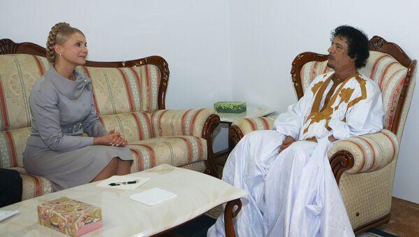 Юлия Тимошенко и Муамар Каддафи во время встречи в Триполи