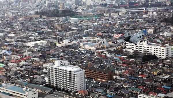 Вид на пострадавший в релуьтате землетрясения город Сендай, префектура Мияги (14 марта 2011)