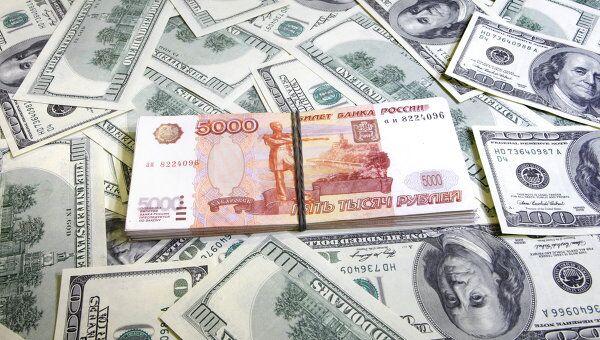 Рубль вырос на открытии торгов в среду на 3 коп против доллара