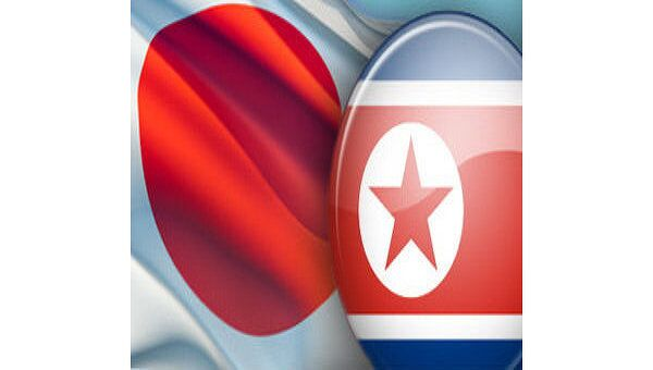 Флаги Японии и КНДР