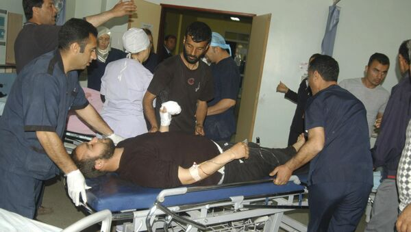 Пострадавшие в результате столкновения сирийской армии и вооруженной оппозиции на границе с Турцией, Килис