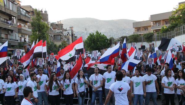 Молодежь Дамаска поздравила Путина с вступлением в должность президента