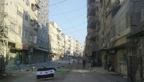 Сирийский флаг на одной из улиц Дамаска