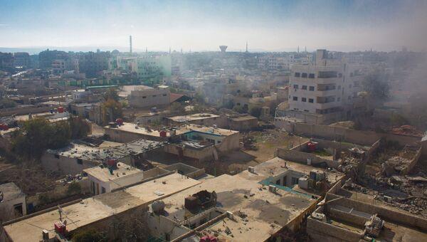 Вид на территорию, занятую боевиками Свободной армии Сирии, в городе Дарайя. Архив