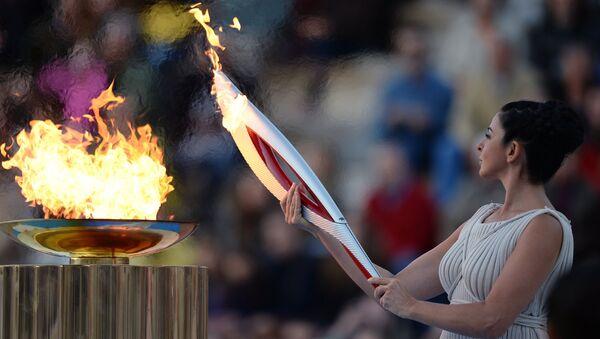 Церемония передачи Олимпийского огня Оргкомитету Сочи 2014