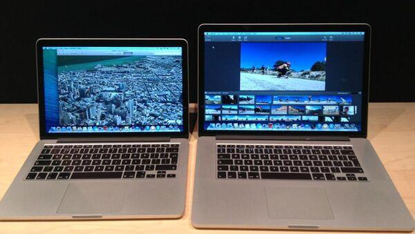 Презентация Apple - Новые ноутбуки MacBook с13-дюймовым и 15-дюймовым дисплеями. Архивное фото