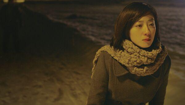 Кадр из фильма Черный уголь, тонкий лед, архивное фото