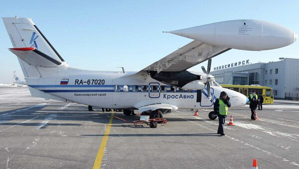 Самолет авиакомпании Красавиа в новосибирском аэропорту Толмачево, архивное фото