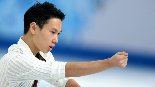 Денис Тен (Казахстан) выступает в произвольной программе мужского одиночного катания на соревнованиях по фигурному катанию