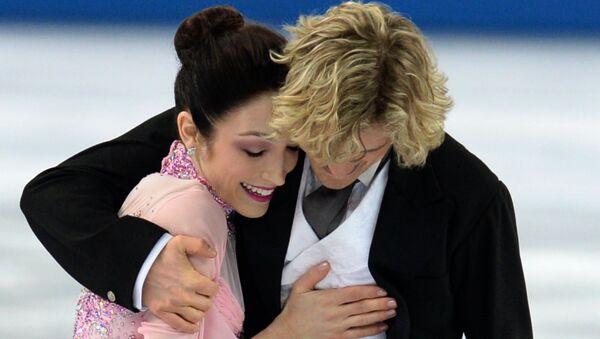 Мерил Дэвис и Чарли Уайт (США) выступают в короткой программе танцев на льду на соревнованиях по фигурному катанию