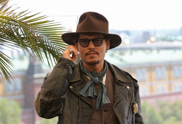 Американский актер Джонни Депп на фотоколле