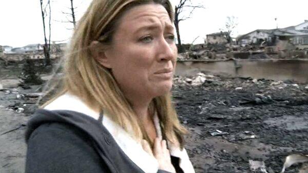 Жители Нью-Йорка плачут и рассказывают о сгоревших из-за урагана домах