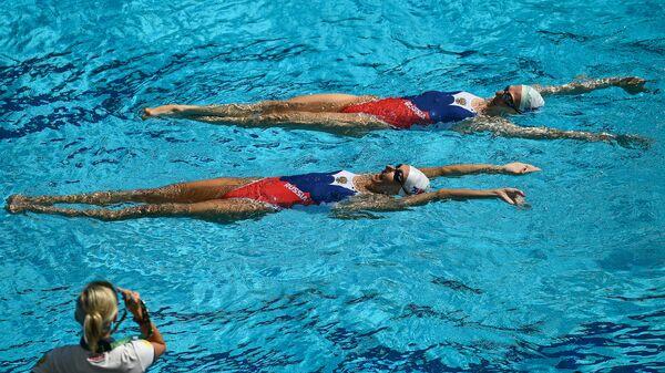 Татьяна Данченко, Наталья Ищенко и Светлана Ромашина во время тренировки