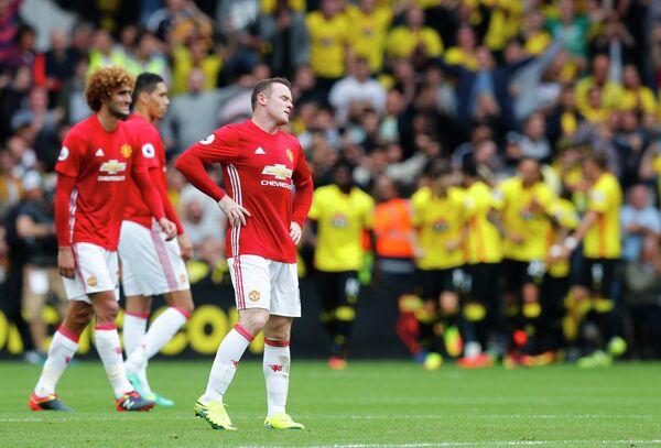Футболисты Манчестер Юнайтед Маруан Феллайни и Уэйн Руни (слева направо)