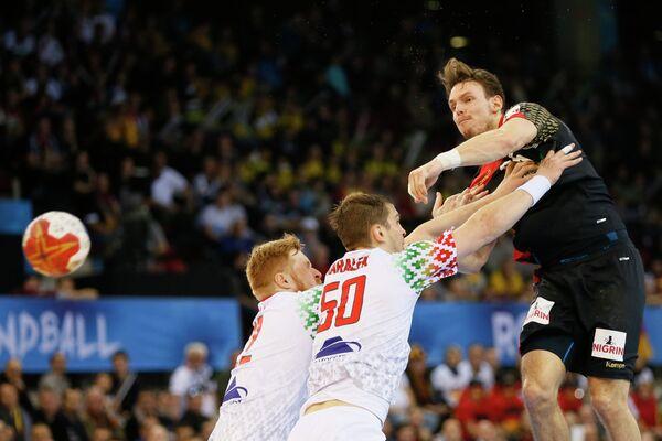 Игровой момент матча чемпионата мира по гандболу между сборными Германии и Белоруссии