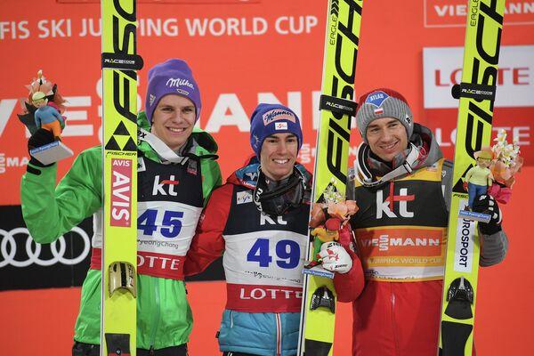 Андреас Веллингер (Германия), Штефан Крафт (Австрия) и Камиль Стох (Польша) (слева направо)