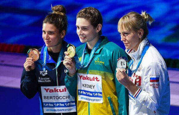 Елена Бертокки (слева), Мэддисон Кини (в центре) и Надежда Бажина