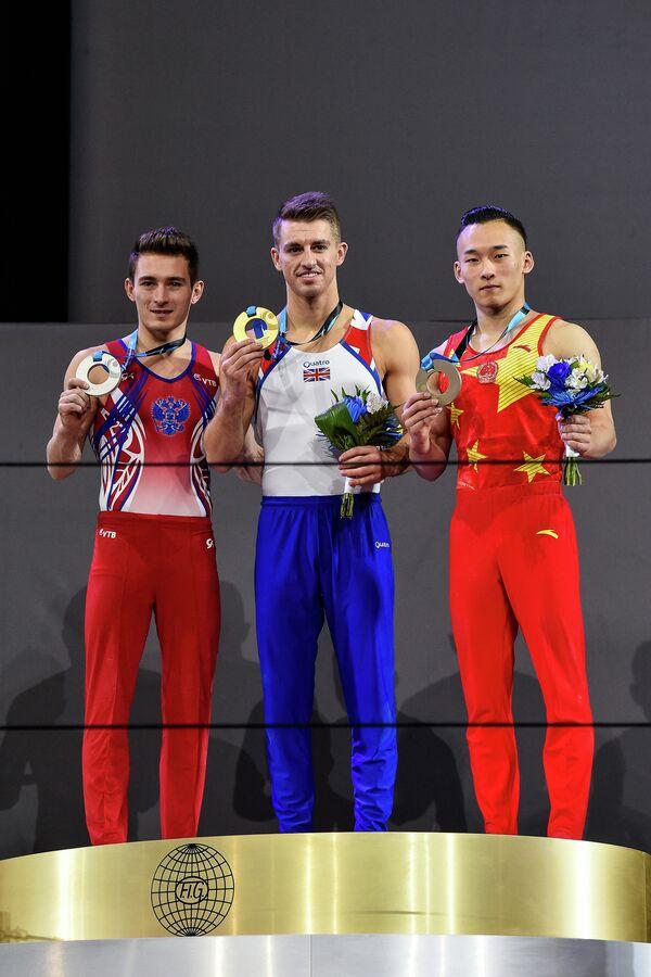 Россиянин Давид Белявский, британец Макс Уитлок и китаец Жотэн Сяо (слева направо)