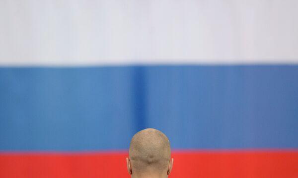 Павел Кулижников и российский флаг