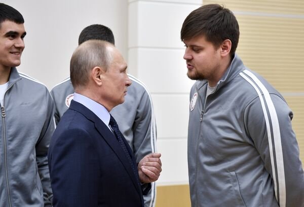 Владимир Путин и Александр Денисьев (на первом плане)
