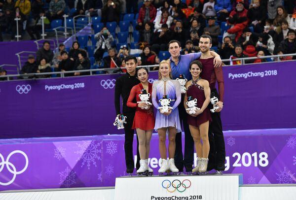 Суй Вэньцзин и Хань Цун, Алена Савченко и Брюно Массо, Меган Дюамель и Эрик Рэдфорд (слева направо)