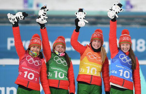 Белорусские биатлонистки Надежда Скардино, Ирина Кривко, Симон Детьё и Динара Алимбекова (слева направо)