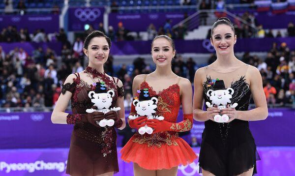 Евгения Медведева, Алина Загитова, Кейтлин Осмонд (слева направо)