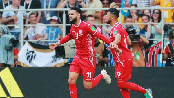 Футболисты сборной Туниса Дилан Бронн и Анис Бадри (Слева направо)