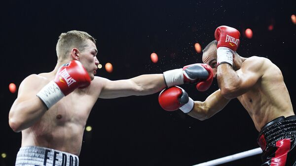 Бой Федора Чудинова (слева) и Наджиба Мохаммеди (справа)