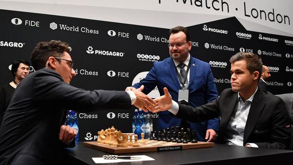 Фабиано Каруана и Магнус Карлсен (слева направо)