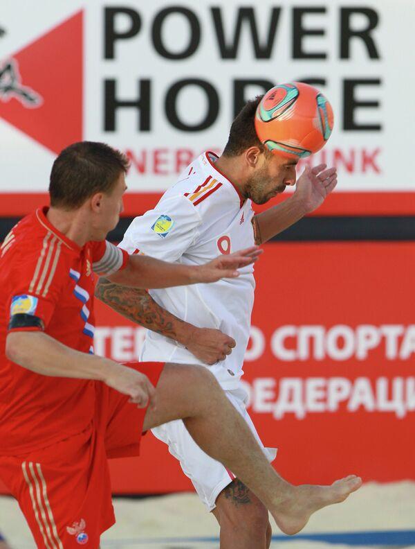Игровой момента матча между сборными Испании и России