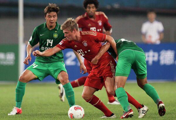 Игровой момент матча Бавария - Бэйцзин Гоань