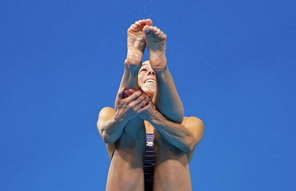 Итальянская прыгунья в воду Таня Каньотто участвует в соревнованиях по прыжкахм в воду с 3-метрового трамплина.