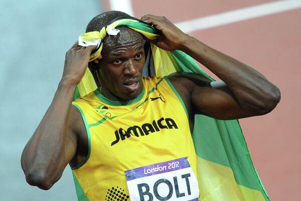 Усэйн Болт после победы в финальном забеге на 100 м