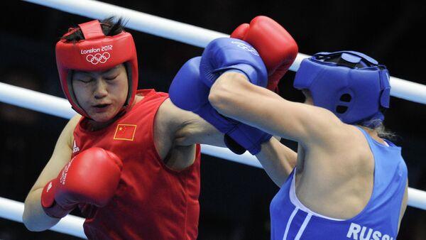 Надежда Торлопова и Ли Цзинь-Цзы (справа налево)