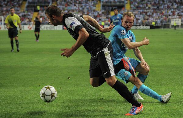 Игровой момент матча Малага - Зенит