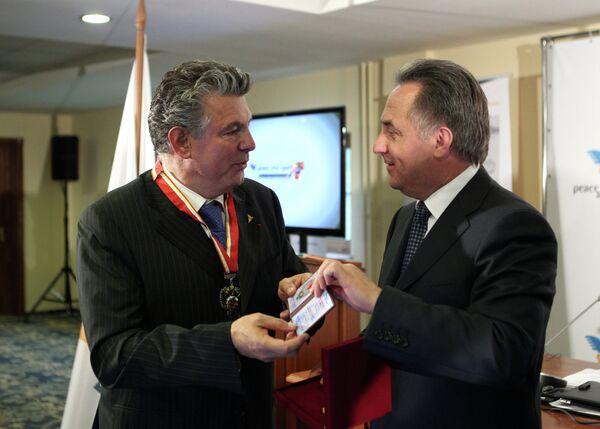 Виталий Мутко и Жоэль Бузу (справа налево)