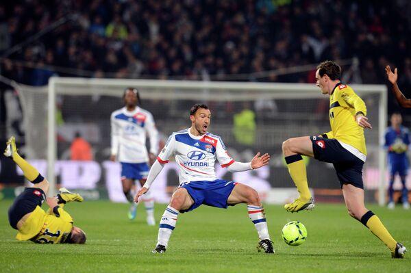 Игровой момент матча Лион - Сошо