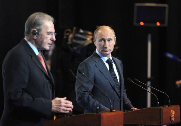 Владимир Путин (справа) и Жак Рогге