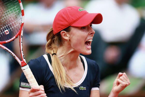 Французская теннисистка Ализе Корне во время матча 3-го круга Ролан Гаррос против Виктории Азаренко