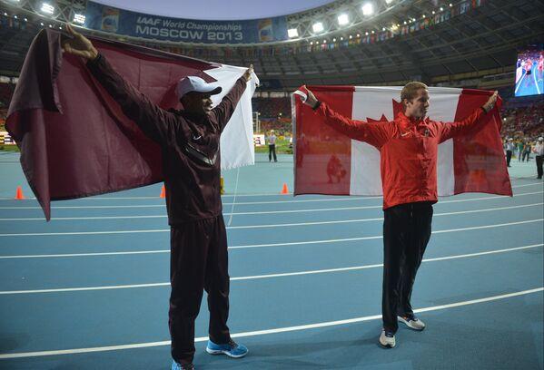 Катарец Мутаз Эсса Баршим (слева) и канадец Дерек Друин