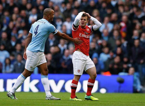 Защитник Манчестер Сити Венсан Компани и полузащитник Арсенала Джек Уилшир
