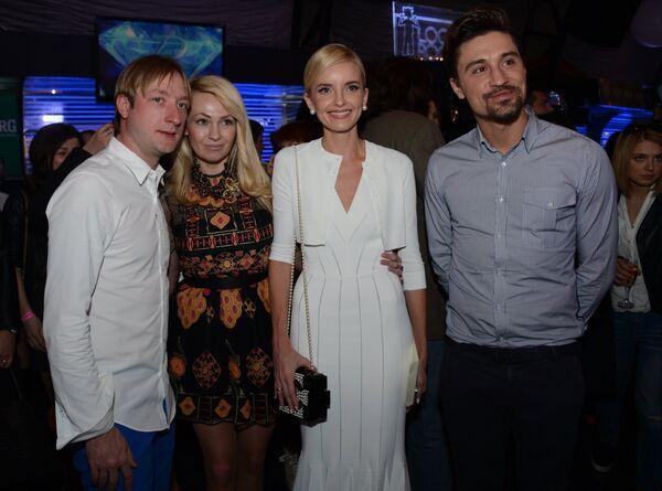 Евгений Плющенко и Яна Рудковская (слева) и Дмитрий Билан со спутницей