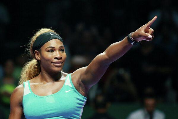 Американская теннисистка Серена Уильямс радуется победе над сербской теннисисткой Аной Иванович.