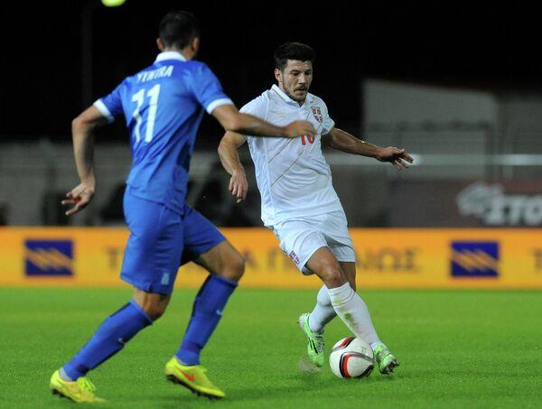 Игровой момент товарищеского матча сборных Сербии и Греции