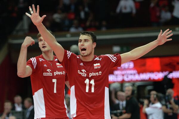Игроки сборной Польши по волейболу Польши Карол Клос (слева) и Фабян Джызга