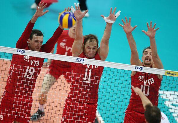 Игроки сборной России Игорь Колодинский, Андрей Ащев и Сергей Савин (слева направо)