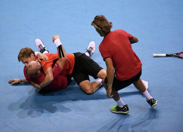 Бельгийские теннисисты Стив Дарсис, Давид Гоффен и Рубен Бемельманс (слева направо)